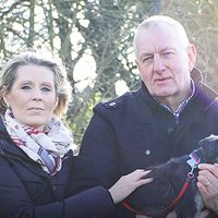 Armed Forces family members to promote mental wellbeing - older couple holding dog