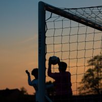 "Footballers at dusk for ""Sporting Force launches August events for Armed Forces community in the North of England"" blog"