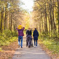Families' transition from military to civilian life - family advice for veterans - family walking in park