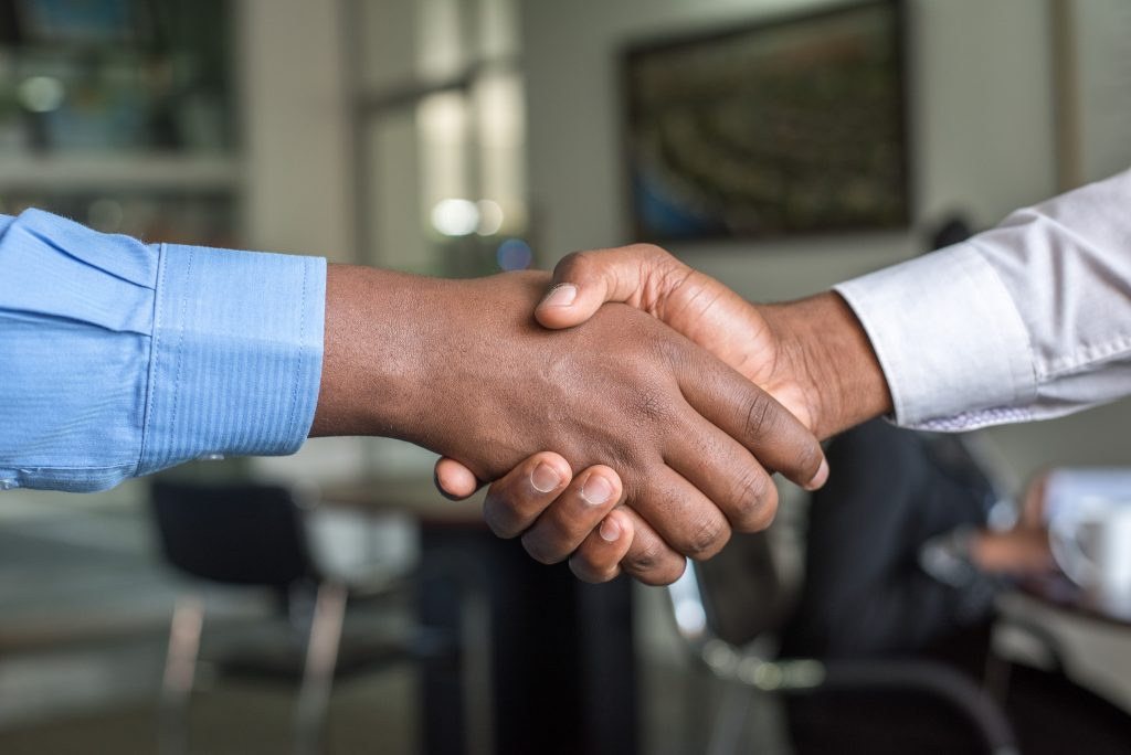 People shaking hands in business attire