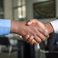 Employment advice for veterans - people shaking hands in business attire