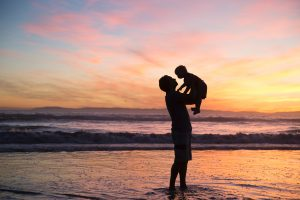 Man holding child in the sea